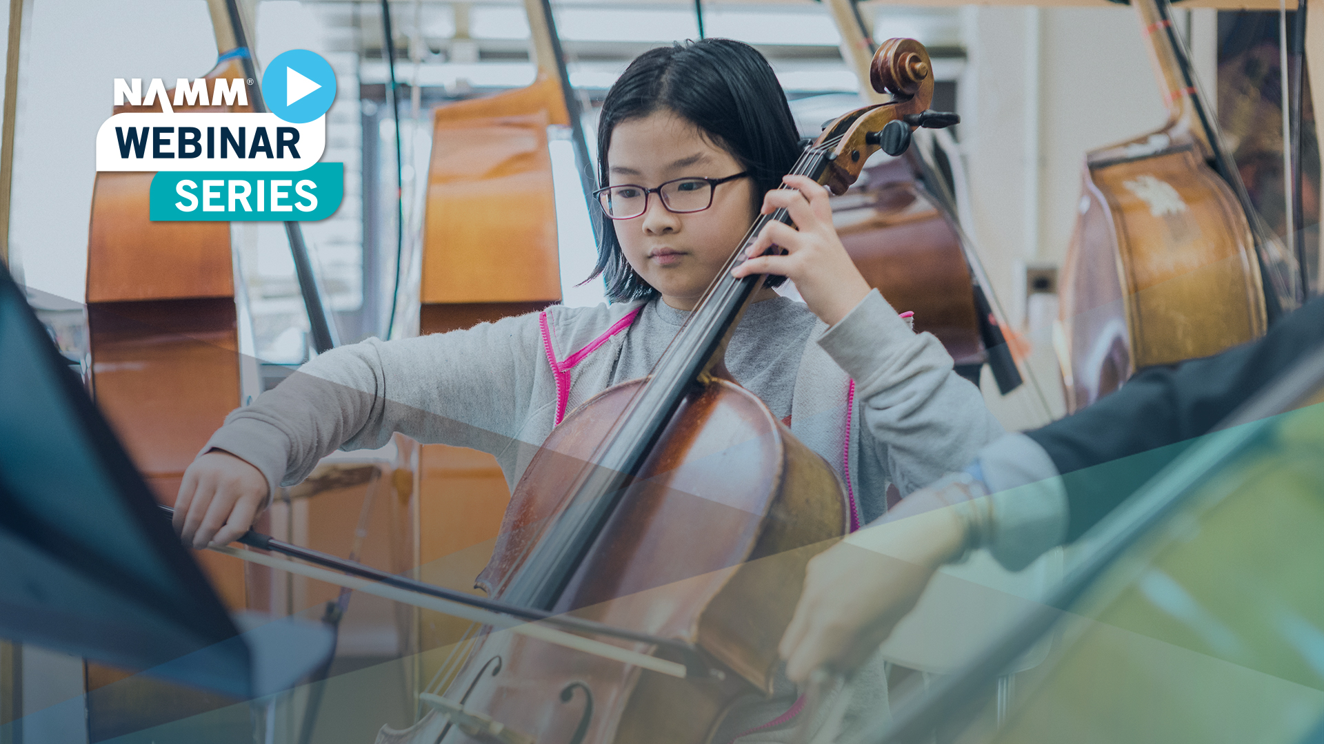 girl learning to play the cello