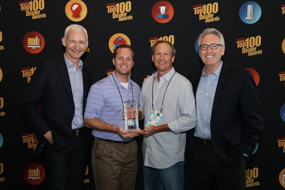 NAMM Chairman Mark Goff and NAMM President and CEO, Joe Lamond with Nick and Pat Averwater of Amro Music, Memphis, TN, Best Customer Service