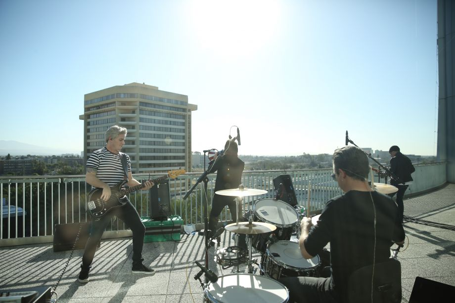 Hollywood U2, a cover band, performs on top of the Hilton