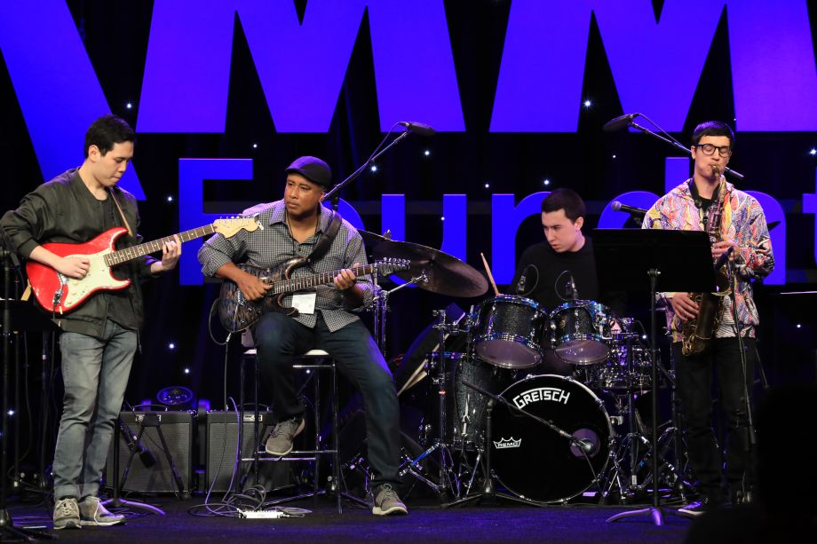 Bernie Williams performs with fellow band members on the NAMM Yamaha Grand Plaza Stage.