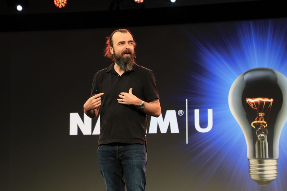 Scott Stratten speaking at the NAMM U Breakfast Session.