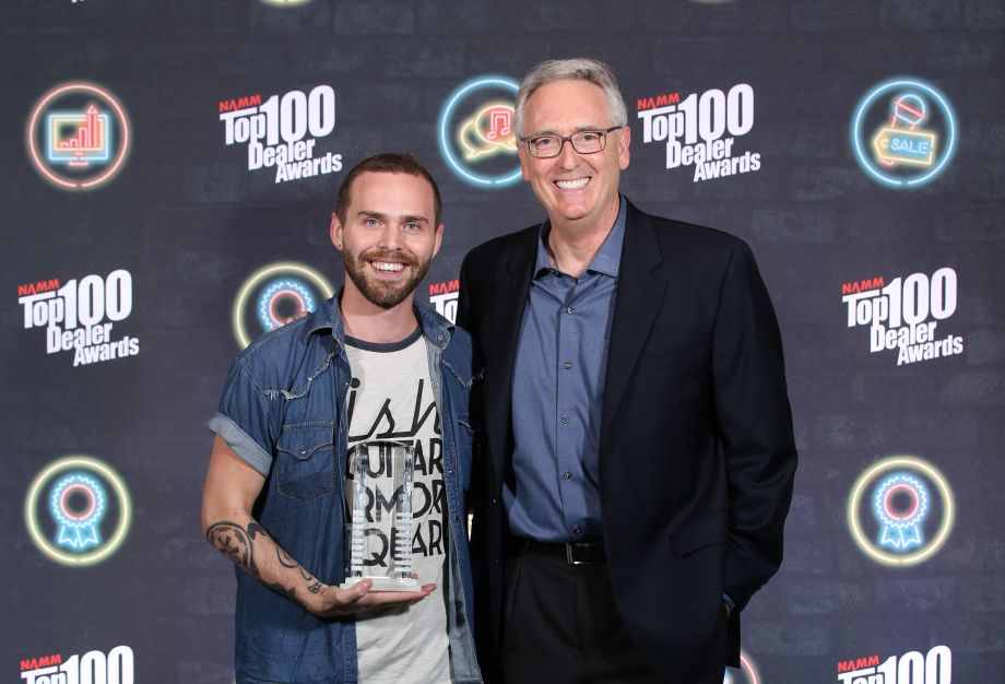 Joe Lamond (right) with Cory Tyson with Ish Music's Top 100 Emerging Dealer Award