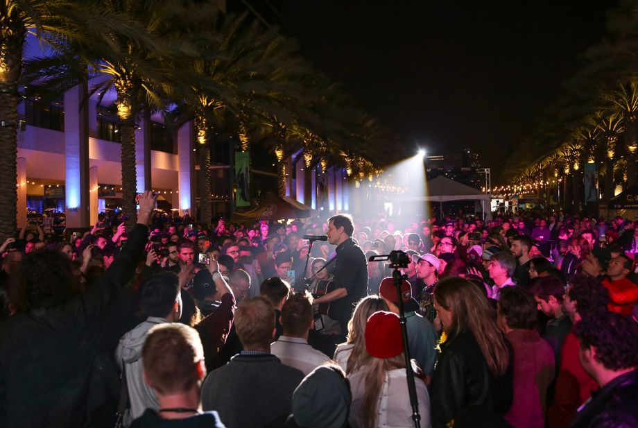 Crowds gather for NAMM's opening night concert with rock band, OK Go