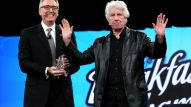 NAMM President and CEO Joe Lamond and Singer Songwriter Graham Nash speak on stage at the 2016 NAMM Show Opening Day at the Anaheim Convention Center on January 21, 2016 in Anaheim, California. (Photo by Jesse Grant/Getty Images for NAMM)