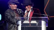 Johnny Depp presents Joe Perry with The Les Paul Award (Photo by Jesse Grant/Getty Images for NAMM)