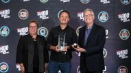 Robin Walenta (left) and Joe Lamond (right) congratulate Lee Anderton of Anderton's Music Co on taking home 2018 Top 100 Dealer of the Year
