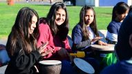 Students participating in a drum circle