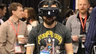 A NAMM attendee tries out a new virtual reality drum set