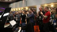 Roomful of Pianos event featured 10, 20 and 50+ pianos playing in unison.