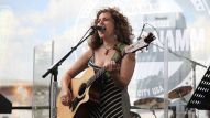 Singer/Songwriter Laura B. Whitmore performs on the NAMM Nissan Stage, Thursday morning.