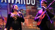 Crystal Gayle and Richard Leigh perform an original for a captivated audience.
